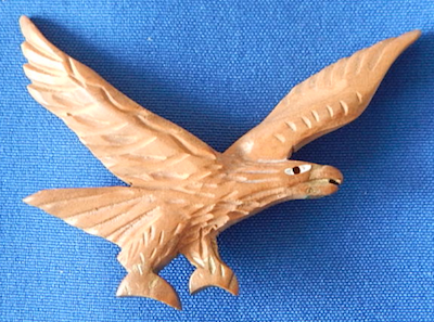 Carved wood eagle pin