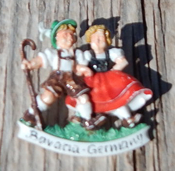 celluloid bavarian couple pin