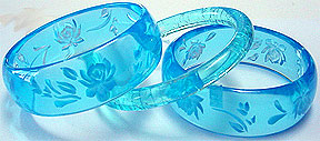 Carved plastic lucite bangles