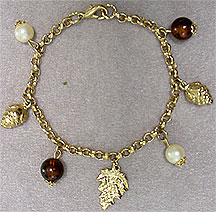 Brown and gold charm bracelet